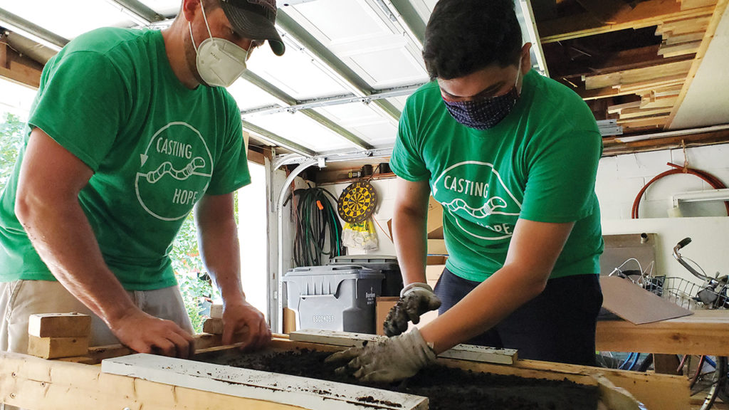 After castings are harvested from the worm box, Daniel Yoder and Jovan sift them to remove partially broken-down items and create a uniform vermicomposting (converting organic waste into fertilizer using earthworms) product. — Daniel Yoder