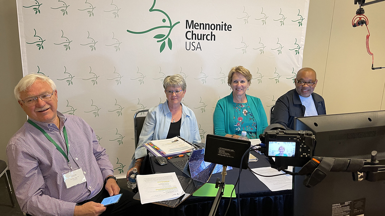 Leading the Mennonite Church USA virtual delegate assembly on July 10 in Cincinnati are, from left, Ed Diller, parliamentarian; Linda Dibble, moderator-elect; Joy Sutter, moderator; and Glen Guyton, executive director. — Mennonite Church USA