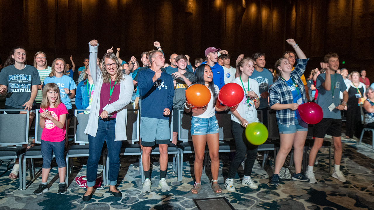 The MennoCon21 crowd responds to worship leaders and musicians in Duke Energy Convention Center. — Mennonite Church USA
