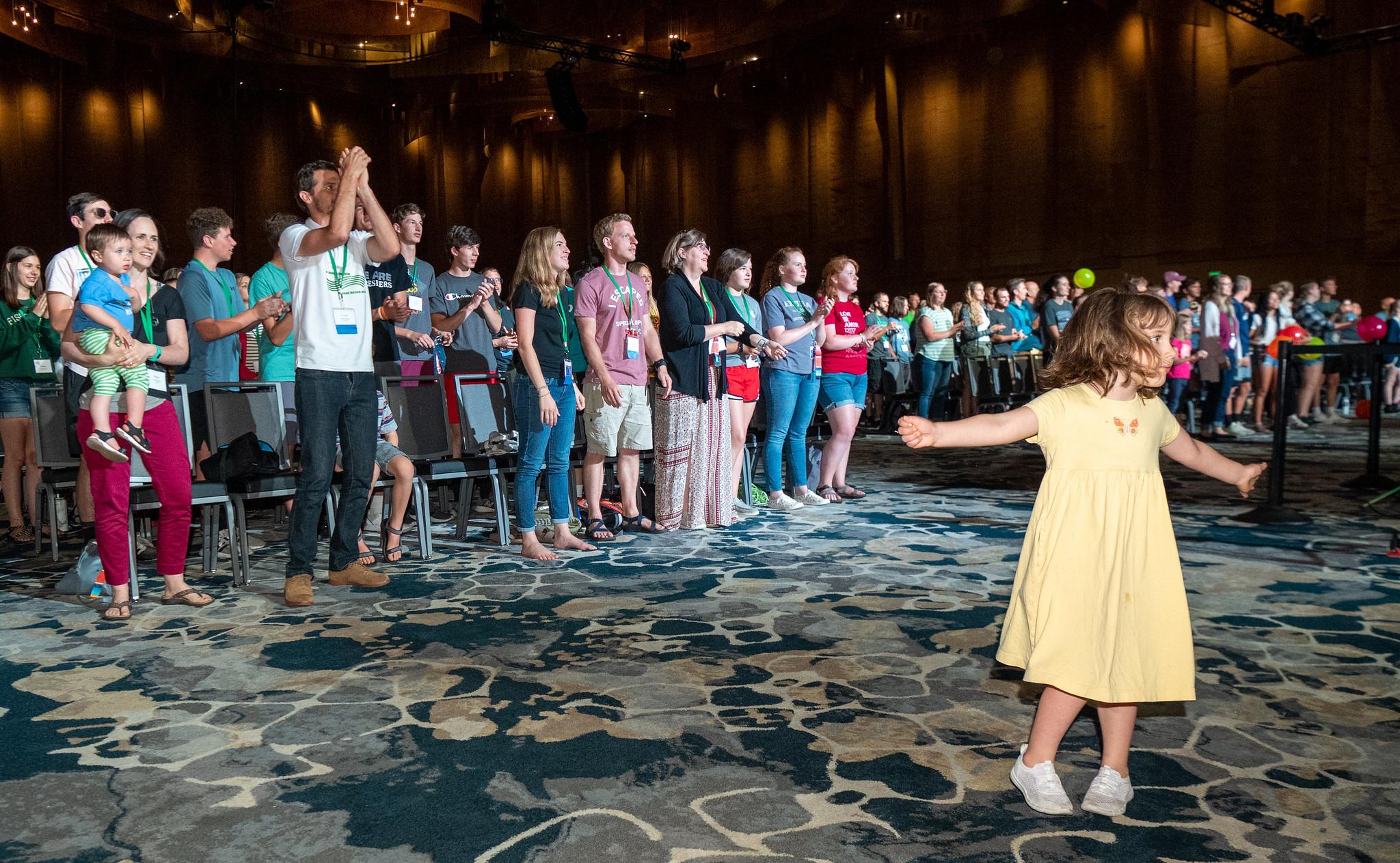 A girl dances to the music of the worship band in Duke Energy Convention Center. — Ken Krehbiel/MC USA