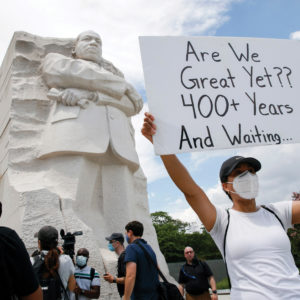 Kimya Hogarth of Silver Spring, Md., takes part in a protest in Washington at the Martin Luther King Jr. Memorial on June 19, 2020, to mark Juneteenth, the holiday celebrating the day in 1865 that enslaved black people in Galveston, Texas, learned they had been freed from bondage, more than two years after the Emancipation Proclamation. — Jacquelyn Martin/AP