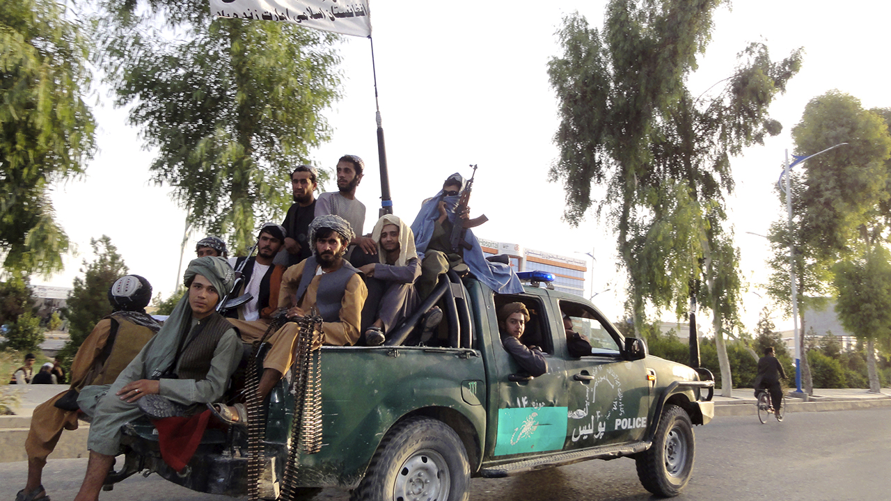 Taliban fighters patrol in Kandahar, Afghanistan, on Aug. 15. — Sidiqullah Khan/AP