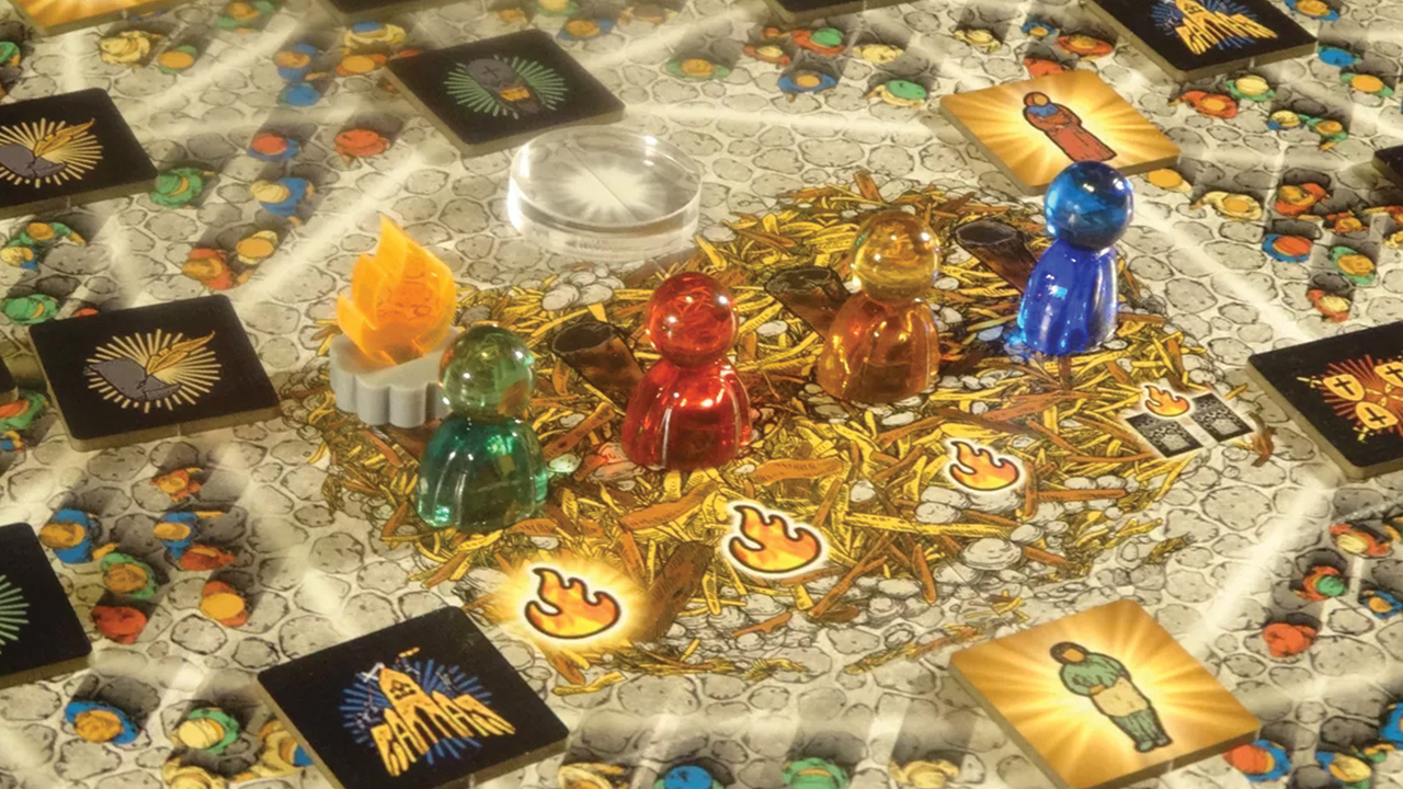 Martyr game pieces sit in the town square at the center of the game board. — John Ratigan