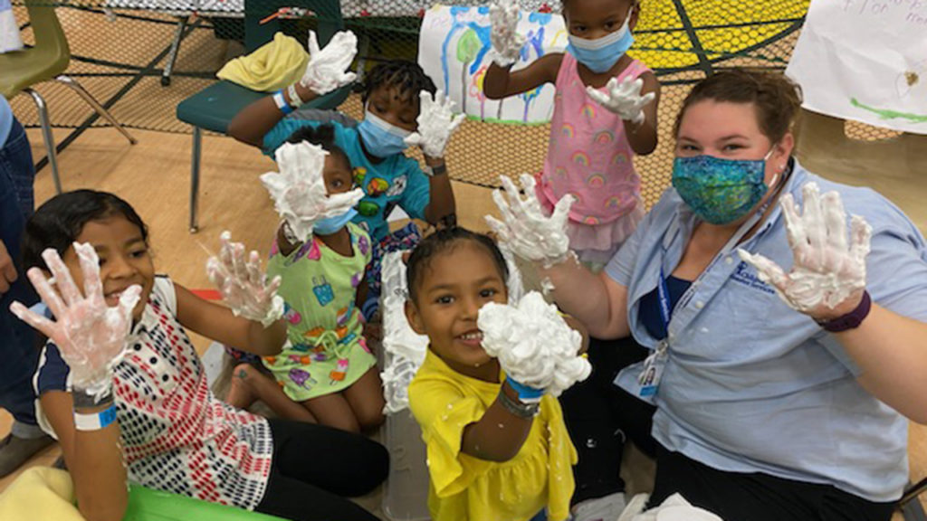 CDS project manager Crystal Baker does an art project with children in September as part of a response to Hurricane Ida in Louisiana. — Children's Disaster Services