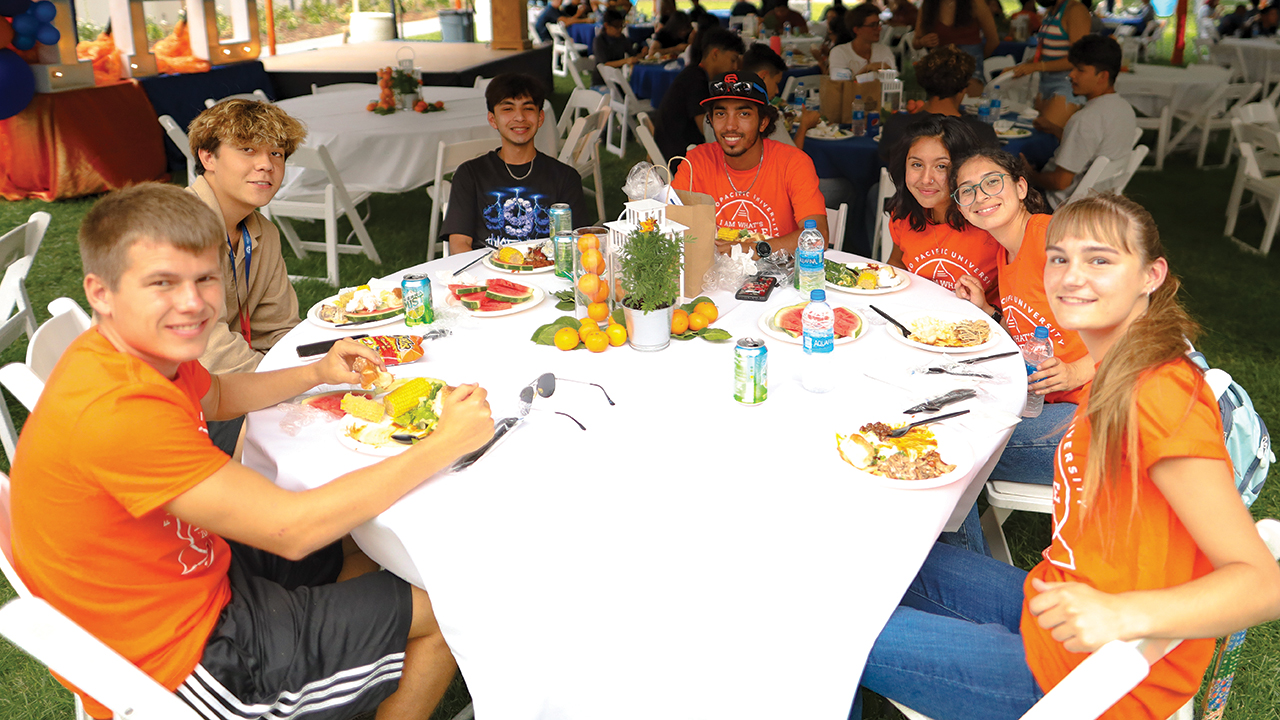 New students enjoy a barbecue during orientation activities on the main Fresno Pacific University campus Aug. 19. — Fresno Pacific University