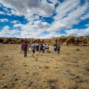 Goshen College students wander between the rock canvases at Petroglyph Canyon in Arizona. — David Lind/Goshen College
