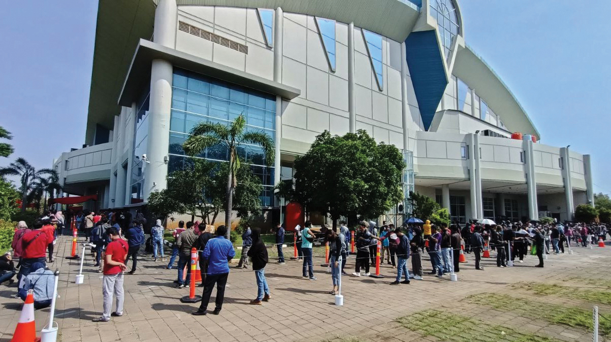 Mennonite World Conference's Global Church Sharing Fund helps workers at Holy Stadium in Semarang, Indonesia, offer vaccines amid a COVID-19 infection wave. — MWC