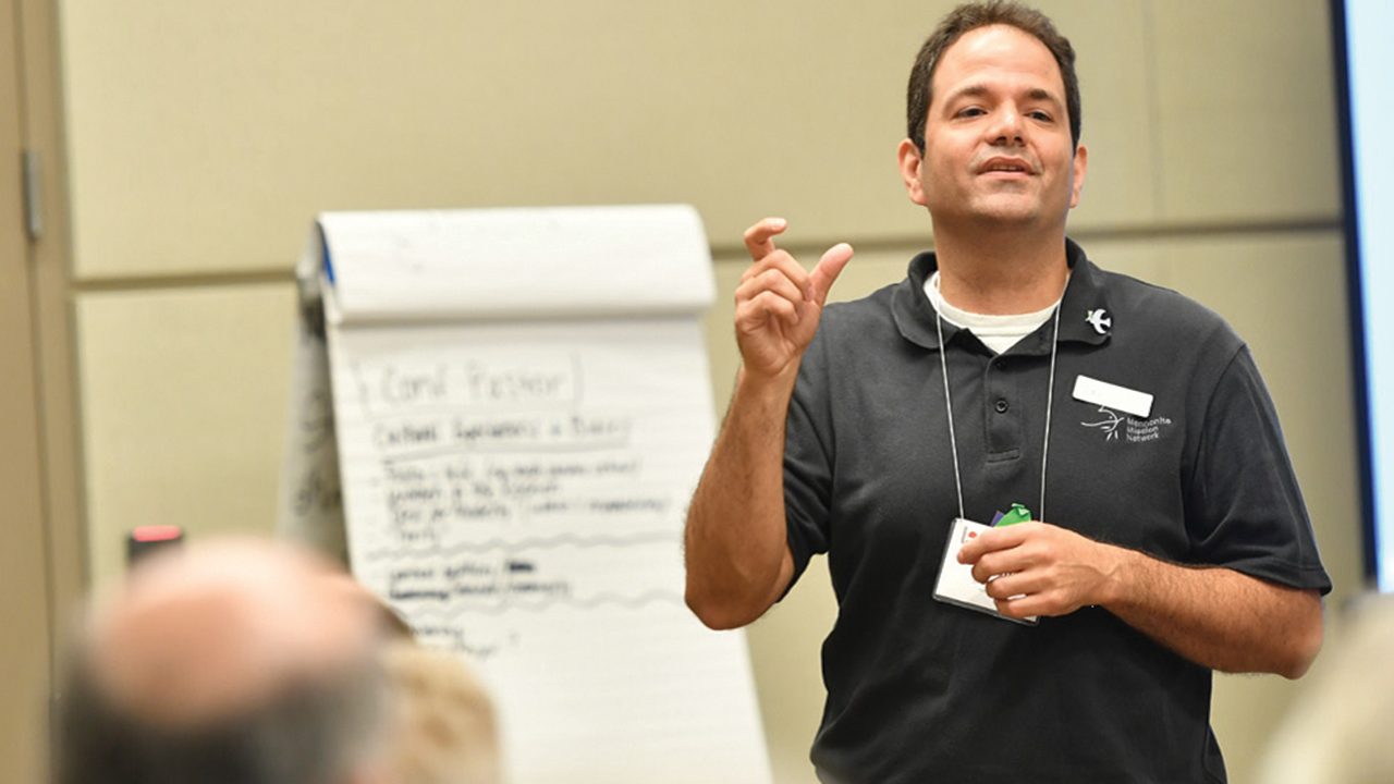 """At the 2017 Mennonite Church USA convention, Jason Boone, Mennonite Mission Network minister of peace and justice, leads a seminar on """"Welcoming Veterans in a Peace Church."""" — Kenneth Krehbiel/MC USA"""