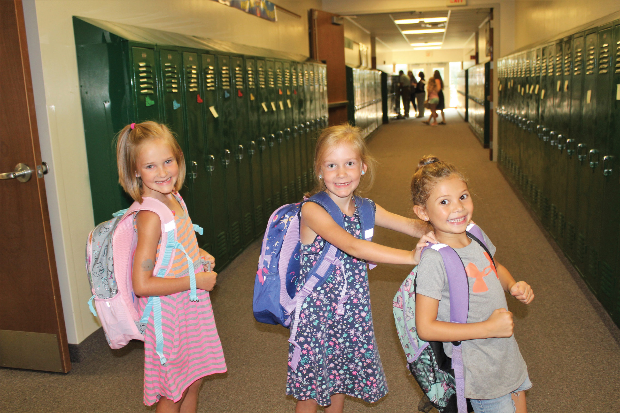 A new school year holds the promise of excitement for three Hunsberger sisters on Aug. 30 at Quakertown Christian School in Pennsylvania. — Erica Talese/Quakertown Christian School